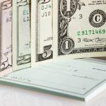 US dollars on checkbook
