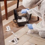 A forensic investigator collecting crime scene evidence