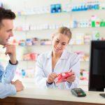 Pharmacist distributing medication